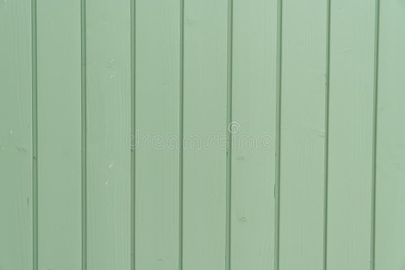 与自然样式的老绿色油漆木头纹理 库存照片