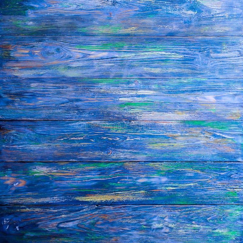 与自然样式的老蓝色木纹理 背景概念-在蓝色背景中绘的老木篱芭 免版税库存图片