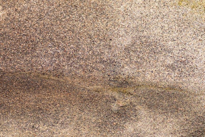 与自然棕色石头的纹理的照片 免版税库存照片