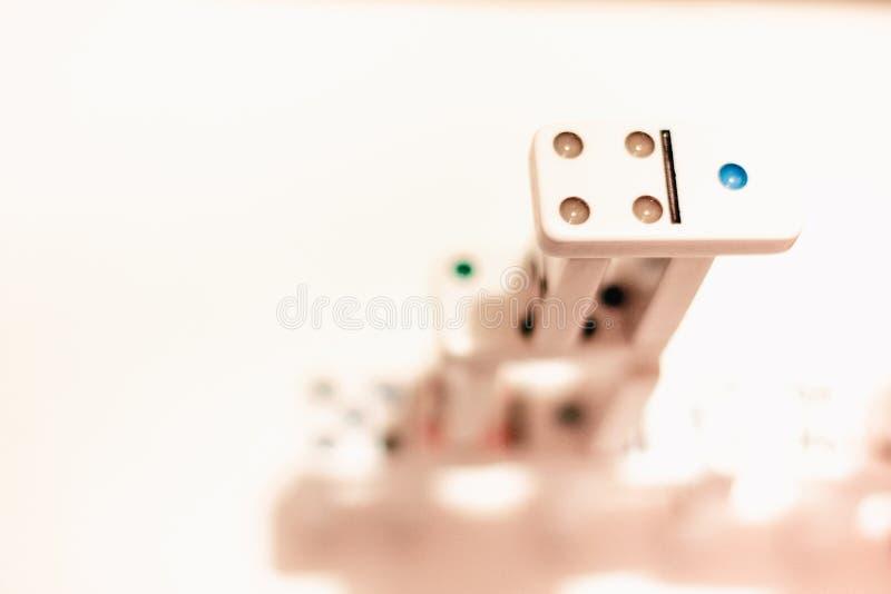 与色的小点的多米诺 图库摄影