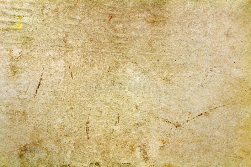 与色的斑点和折叠的葡萄酒纸纹理表面上 抽象背景 免版税库存照片
