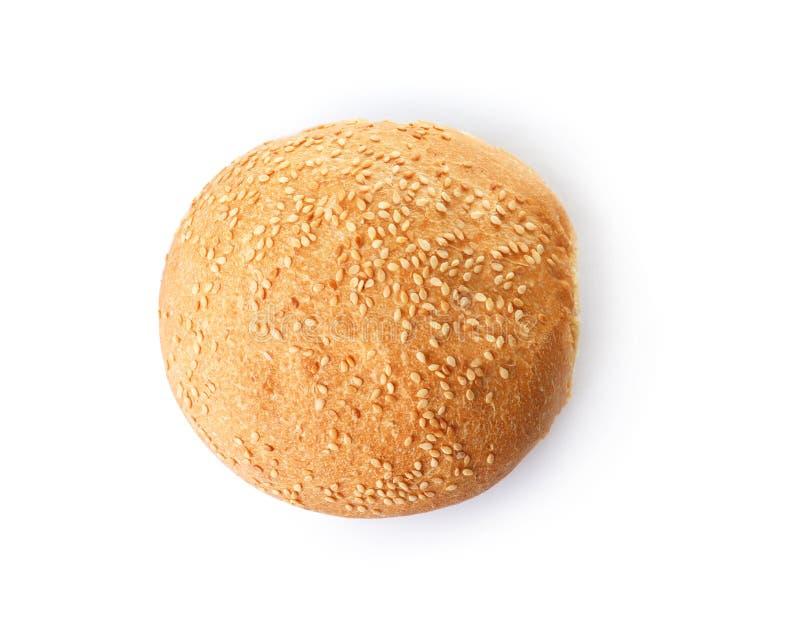 与芝麻的新鲜的汉堡小圆面包在白色,顶视图 免版税库存图片