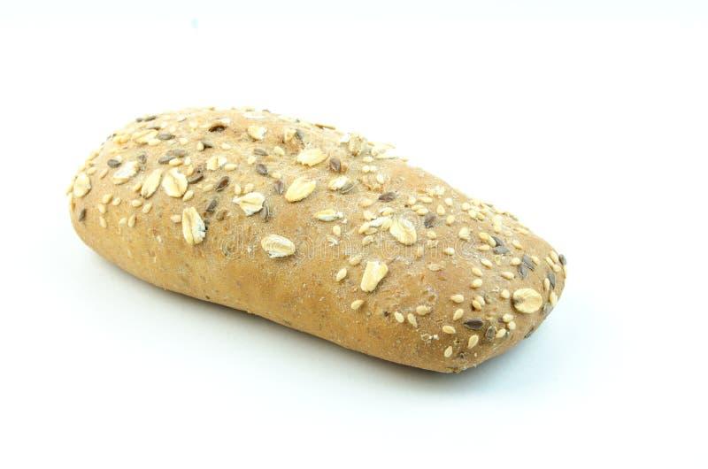 与芝麻籽和燕麦剥落的小圆面包 免版税库存图片