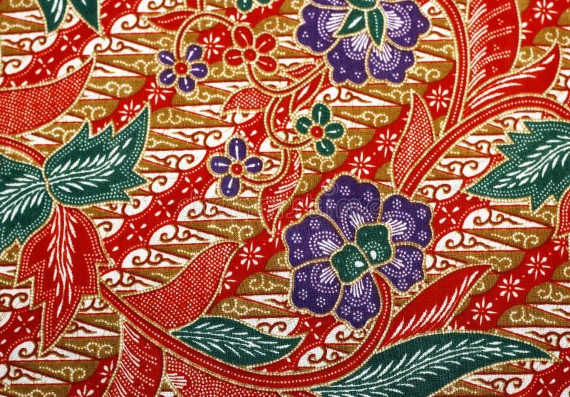 与花卉蜡染布样式的织品 库存照片