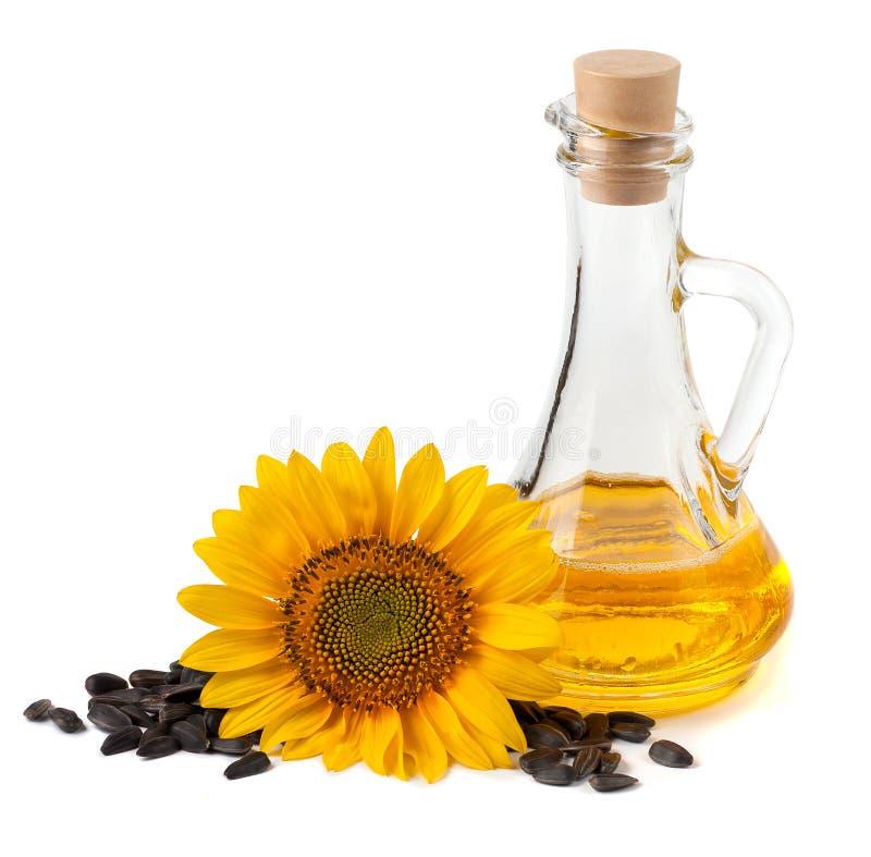 与花和种子的向日葵油 免版税库存照片