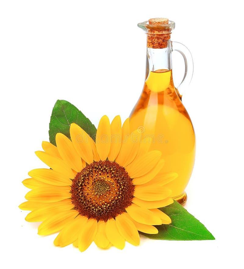 与花的向日葵油 免版税库存照片