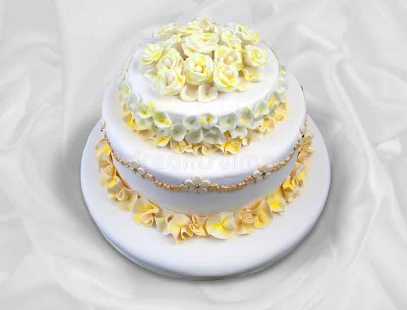 与花的婚宴喜饼 免版税库存照片