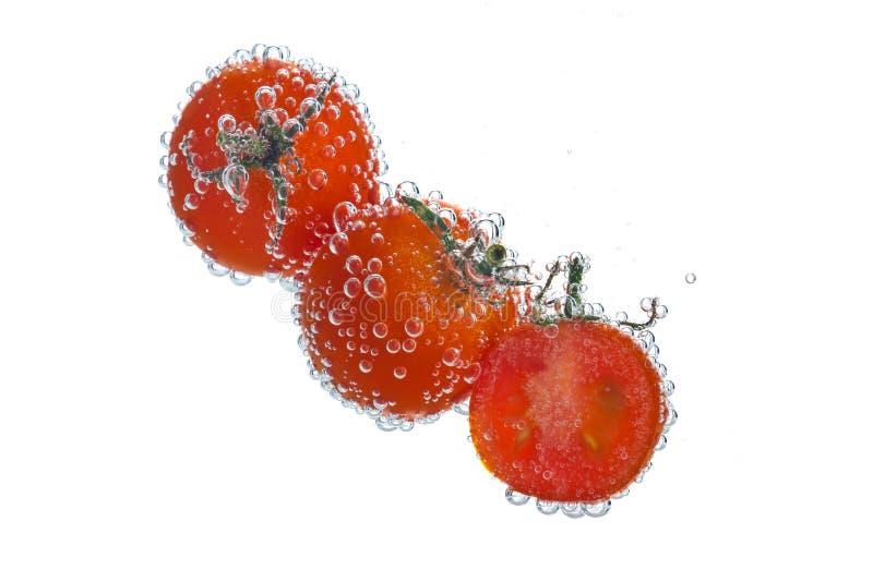 与苏打泡影的蕃茄 图库摄影