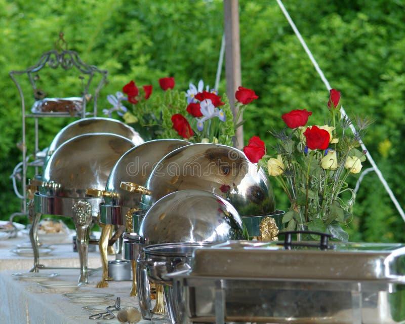 与英国兰开斯特家族族徽和银的自助餐 库存图片