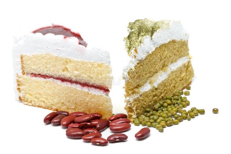 与草莓蛋糕的绿茶蛋糕 奶油被装载的饼干 库存图片