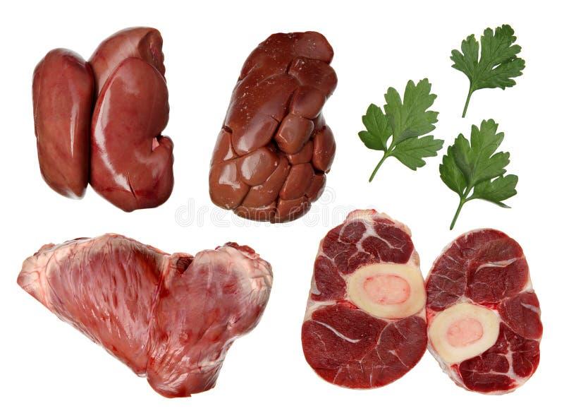 与荷兰芹叶子的新鲜的肉产品 免版税库存照片