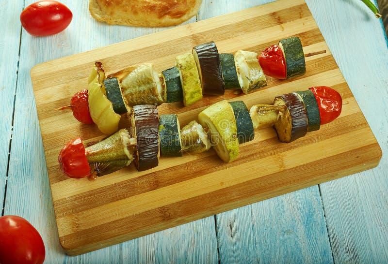 与菜的西西里人的鳕鱼kebab 免版税库存照片