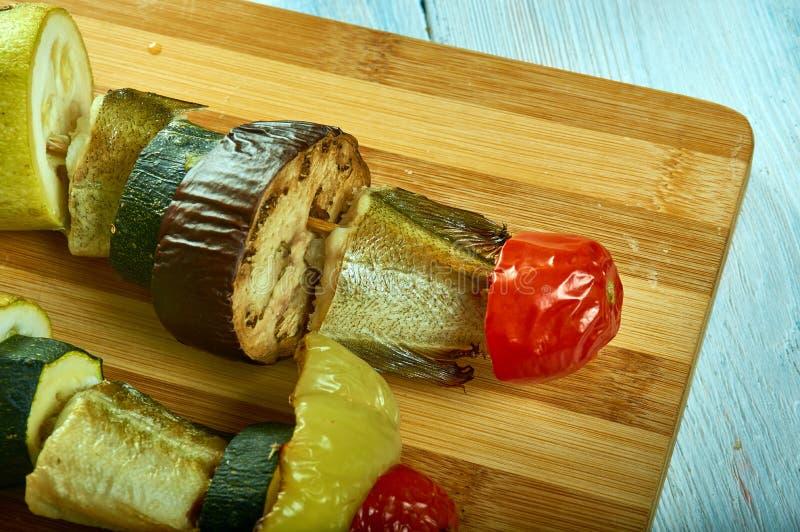 与菜的西西里人的鳕鱼kebab 免版税图库摄影