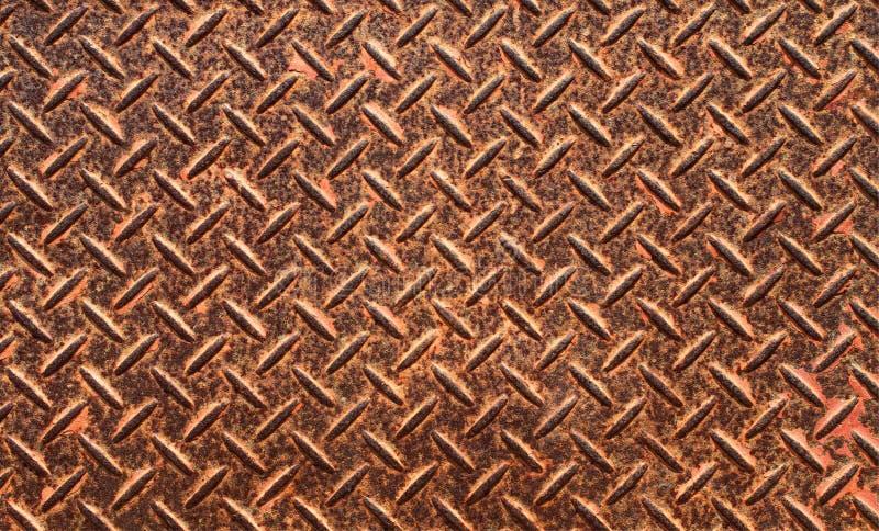 与菱形形状的生锈的钢板纹理 免版税库存图片