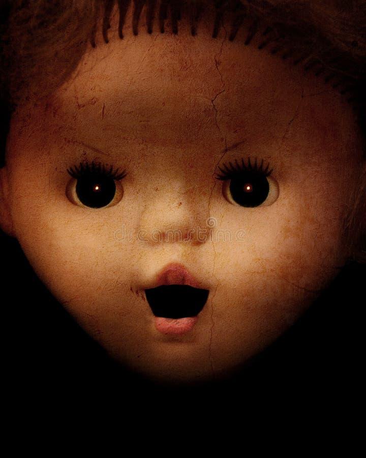 与葡萄酒邪恶的鬼的玩偶面孔的难看的东西背景 免版税库存图片