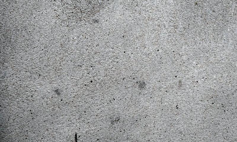 与葡萄酒难看的东西的轻的乌贼属背景或与软的米黄脏的污点的被擦的油漆纹理 库存图片