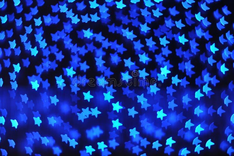 与蓝星光的背景 免版税库存照片