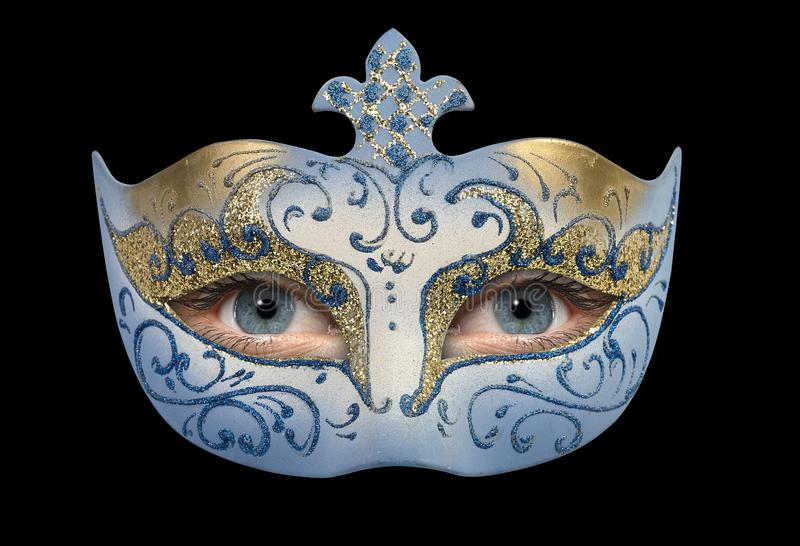 与蓝灰色女孩眼睛的狂欢节面具 库存照片