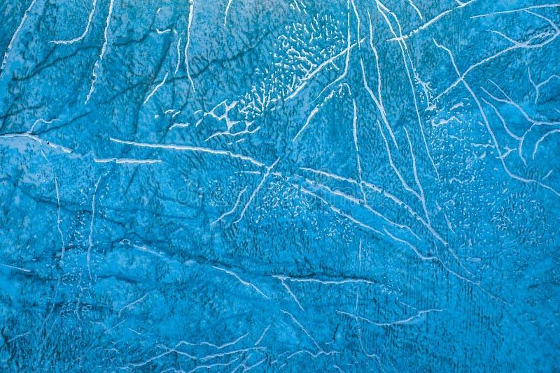 与蓝色抽象样式的亚麻油地毡与明亮的金黄条纹 免版税库存图片