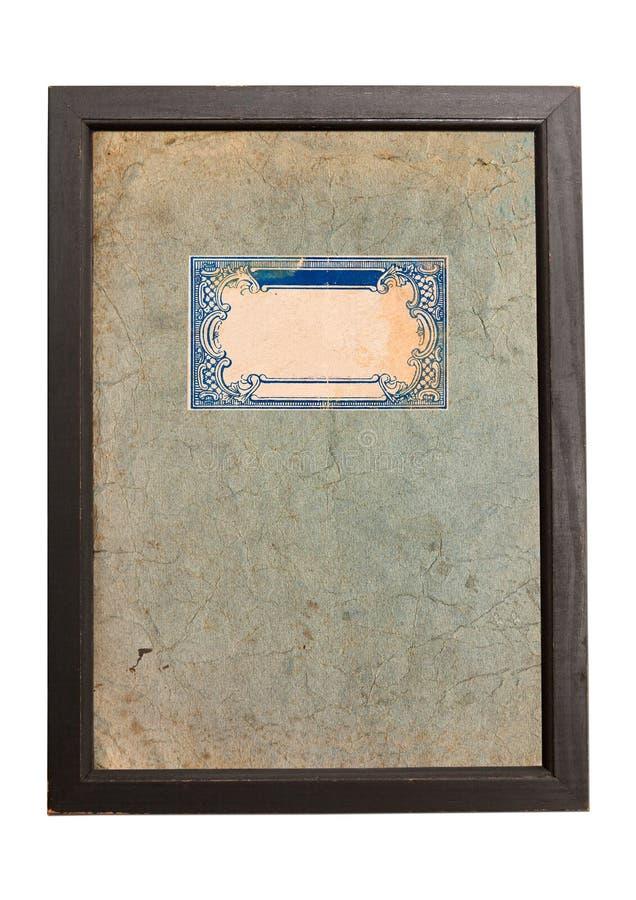 与蓝色装饰品的老纸纹理背景在木制框架 库存图片