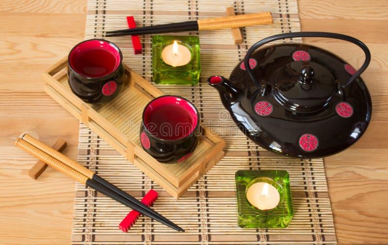 与蜡烛的日本静物画 图库摄影