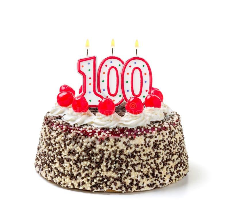 与蜡烛第100的生日蛋糕 免版税图库摄影
