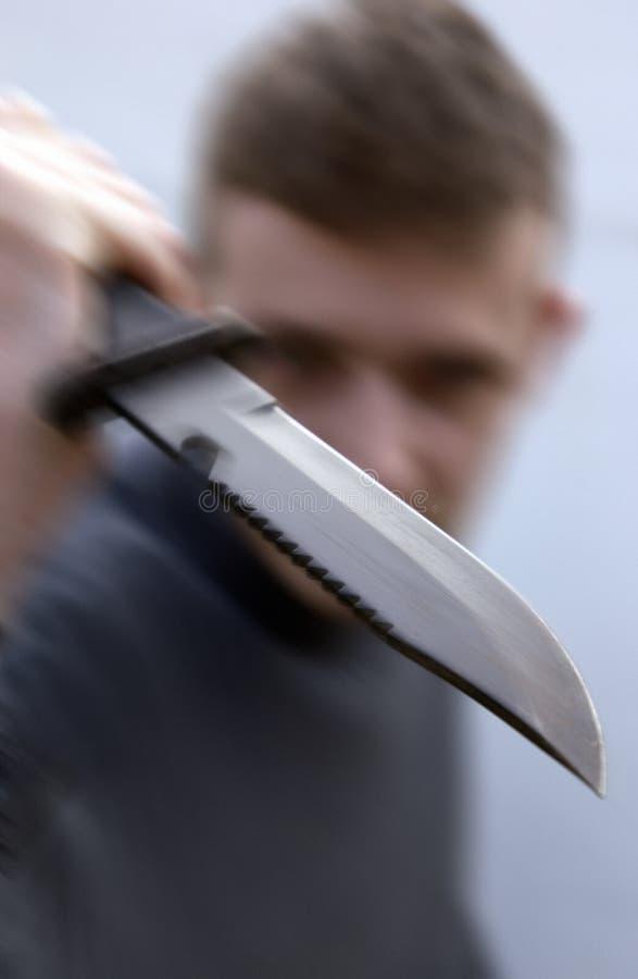 与行动迷离的猛烈刀子攻击 图库摄影