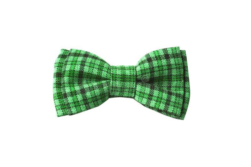 与衣服饰物之小金属片的绿色蝶形领结为圣帕特里克的天 免版税库存图片