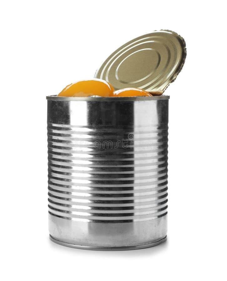与被保存的桃子一半的锡罐 免版税库存图片