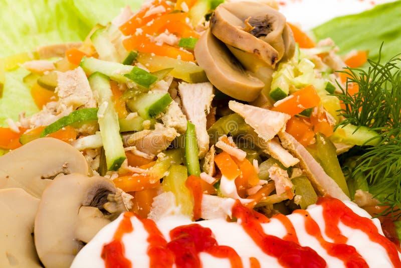与被分类的绿色的沙拉,油煎的猪肉,红萝卜 库存图片