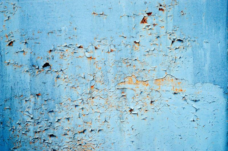 与被摩擦的油漆的老铁锈铁和污点电烙backgrou 库存图片
