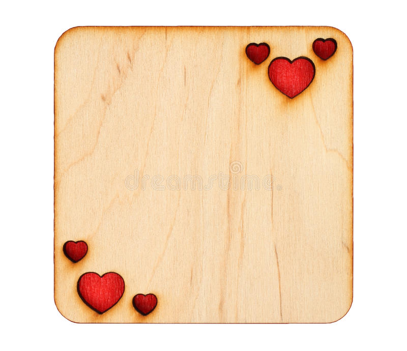 与被烧焦的心脏的木贺卡与里面红色纸 库存图片