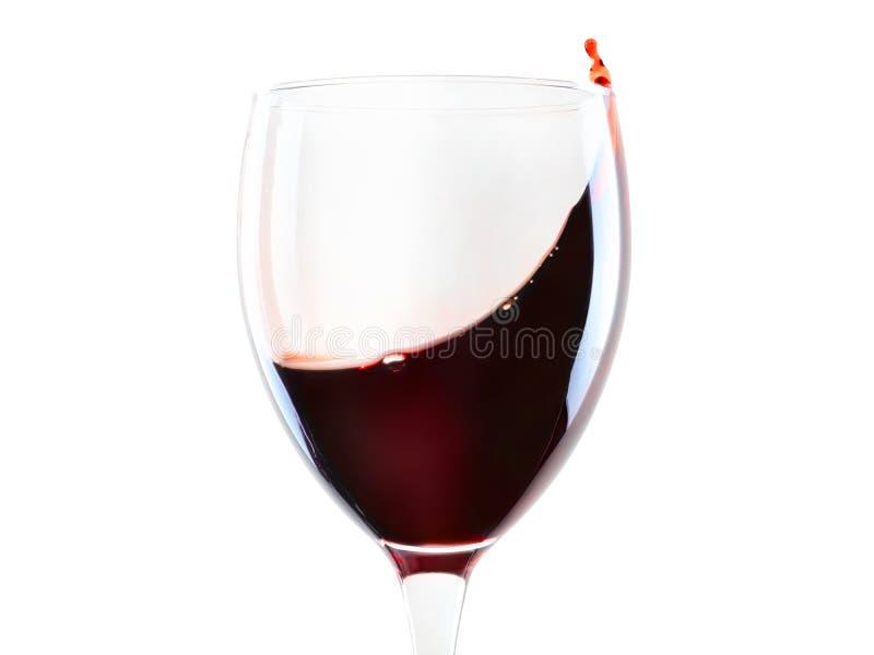 与被隔绝的飞溅的红葡萄酒玻璃 免版税库存照片