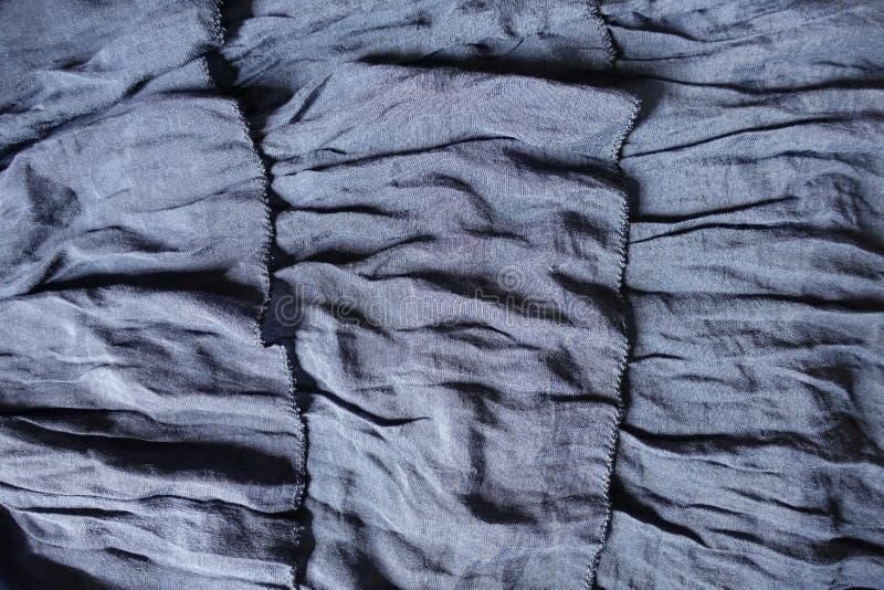 与装饰衣裙3行的稀薄的蓝色织品  库存照片