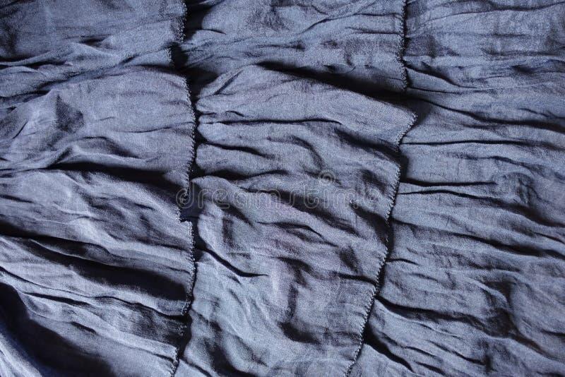 与装饰衣裙3行的蓝色织品  库存图片