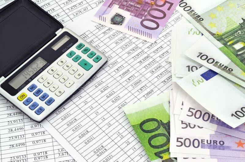 与计算器和财政数字的金钱 库存图片