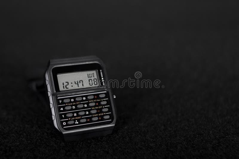 与计算器的数字手表 库存照片