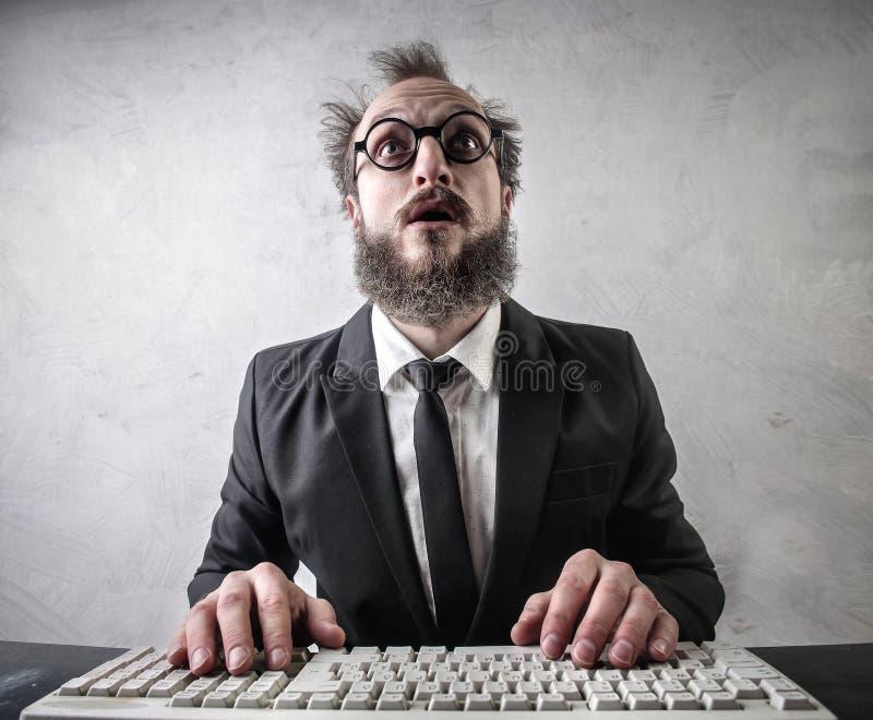 与计算机的生意人 免版税图库摄影