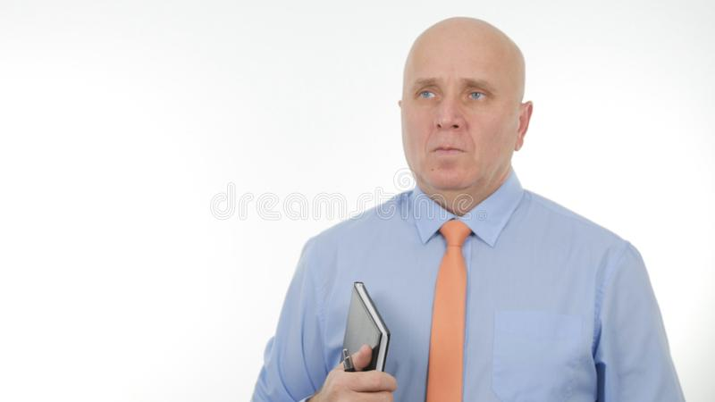 与议程的确信的商人图象在他的手上 库存图片