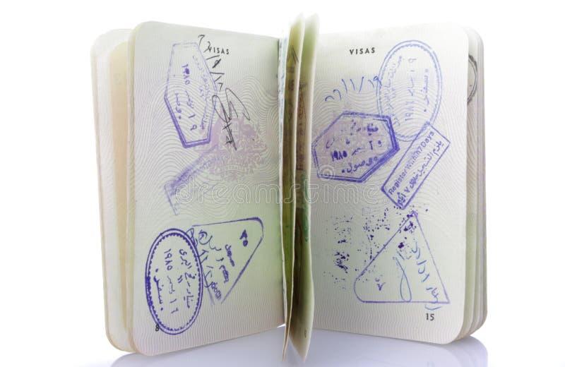 与许多签证的护照 免版税库存照片