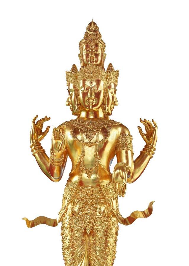 与许多面孔和胳膊的金黄佛教雕象 库存照片