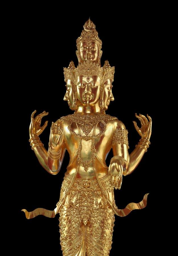 与许多面孔和胳膊的金黄佛教雕象 免版税库存照片