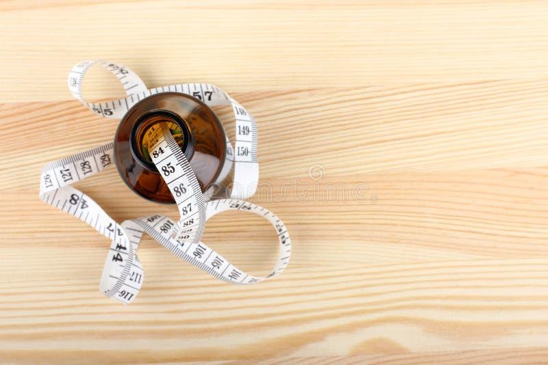 与评定的磁带的饮食药片 免版税图库摄影