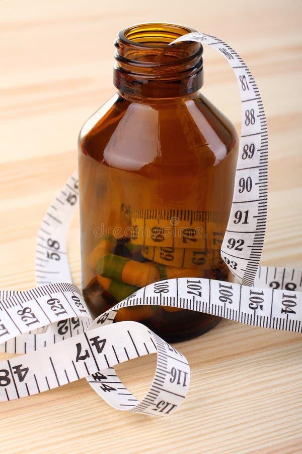 与评定的磁带的饮食药片 库存图片