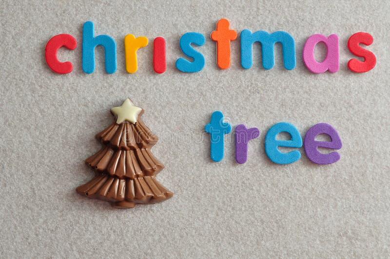 与词圣诞树的巧克力圣诞树 免版税库存照片