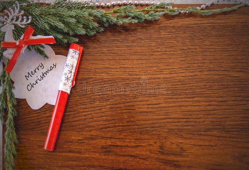 与词的圣诞卡片:圣诞快乐 免版税库存图片