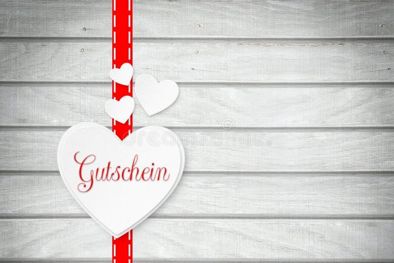 与词`优惠券`的心脏用德语 免版税库存图片