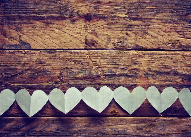与诗歌选纸心脏的情人节背景 图库摄影