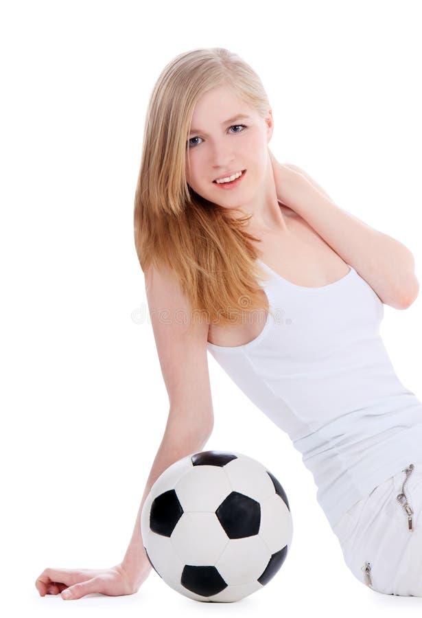 与足球的年轻女性开会 免版税图库摄影
