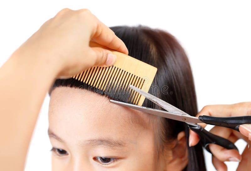 与轰隆的中国传统hairstlye 免版税库存照片